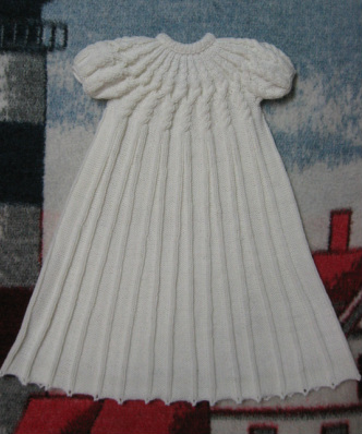 Free Knitting Pattern Baby Christening Gown : Raveled Cables Christening Gown - Judys Knitting Page